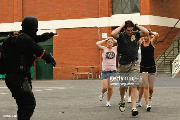 'Hostages' are rescued as police in the Australian state of Victoria conduct a chemical biological radiological hostage exercise at Caulfield...