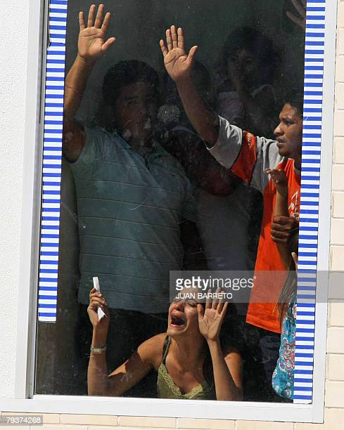 Hostages held in a branch of the Banco Provincial in Altagracia de Orituco in the state of Guarico ask for help from the window of the bank on...