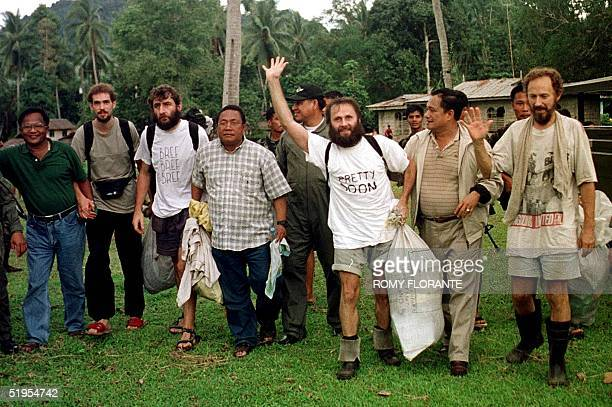 Hostages Marc Wallert of Germany, Stephane Loisy of France, Risto Vahanen of Finland and Seppo Fraenti are fetched by Government emissaries Ernesto...