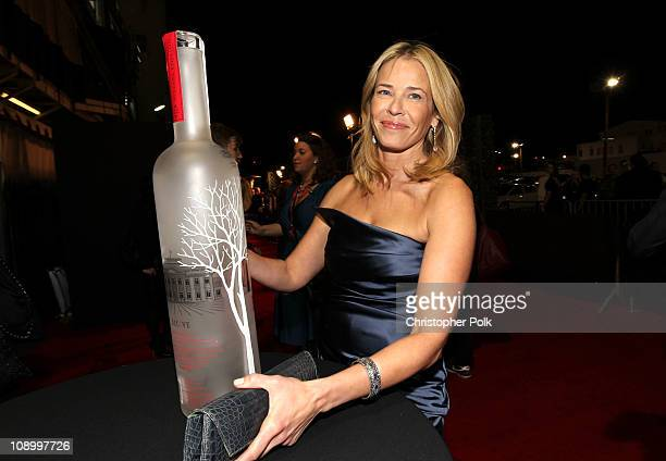 Host/author Chelsea Handler signs the RED bottle as she arrives at the RED launches with Usher on February 10 2011 in Hollywood California