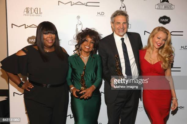 Host/comedian Loni Love hair stylists Pauletta LewisIrwin Matt Danon recipients of the Best Period and/or Character Hair StylingFeatureLength Motion...