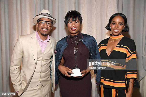 Host/emcee Nick Cannon Grace Kelly Award Winner Jennifer Hudson and singer Kelly Rowland pose with award during 2016 March of Dimes Celebration of...