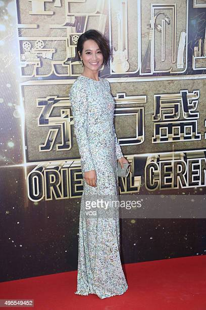 Hostess and actress Zhu Dan arrives at the red carpet of the 2015 Asian Influence Award Oriental Ceremony at Beijing Workers' Gymnasium on November...