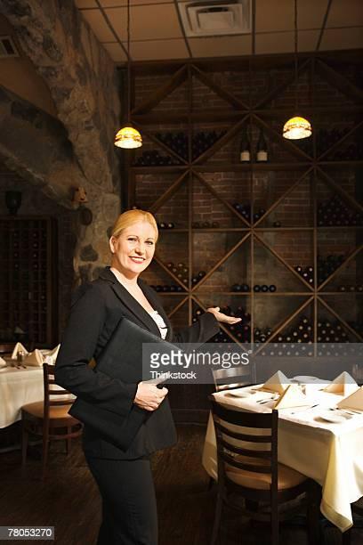 hostess at fine restaurant - weitwinkel stock-fotos und bilder