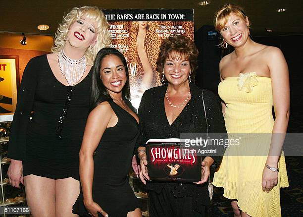 Hostess Cashetta and actress Lin Tucci pose with Nilsa and Heather from Scores Gentlemens Club at a special screening of Showgirls to celebrate the...