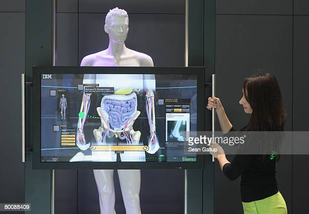Hostess demonstrates the Anatomic Symbolic Mapper Engine at the IBM stand at the CeBIT technology fair a day before the fair's official opening on...