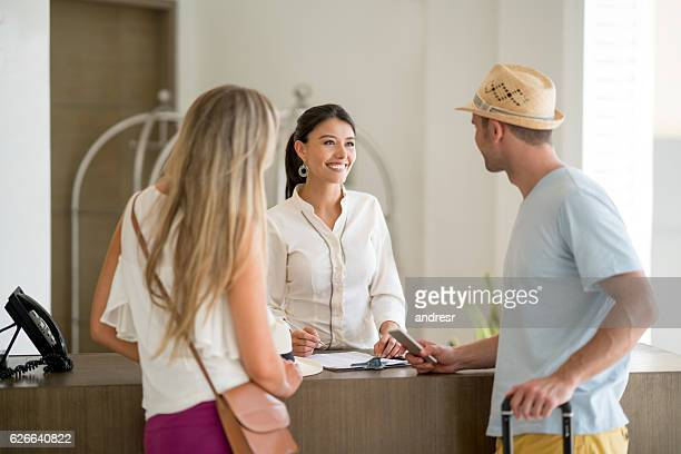 Hostess doing the check-in of a couple