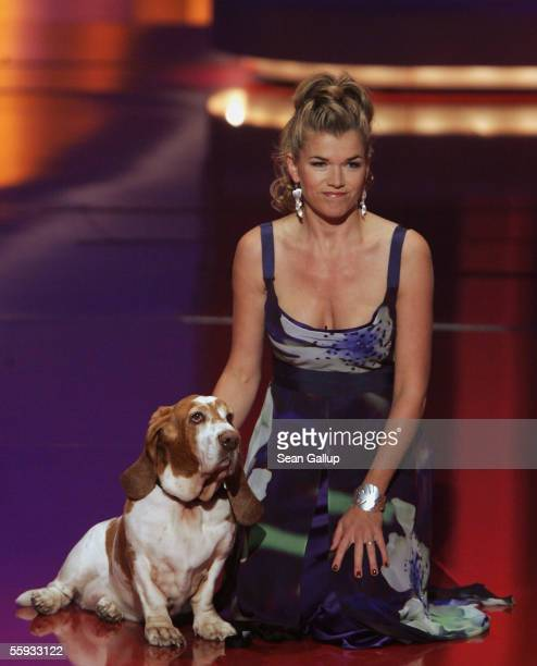 Hostess for the evening Anke Engelke clowns with a dog between awards at the German Television Awards at the Coloneum on October 15 2005 in Cologne...