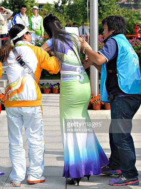 Hostess is attended after she felt uncouncious on the ground during the medal ceremony of the women's 1000m dragon boat straight race at the 16th...