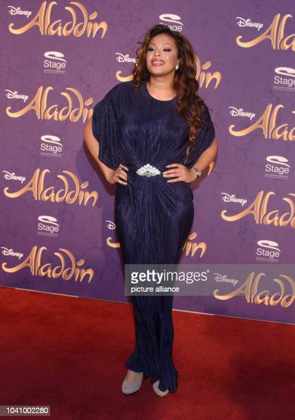 Hostess Khadra Sufi arrives to the Theater Neue Flora for the premiere of the Disney musical 'Aladdin' in Hamburg Germany 06 December 2015...