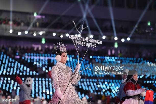 A hostess leads Olympic Athletes from Russia during the opening ceremony of the Pyeongchang 2018 Winter Olympic Games at the Pyeongchang Stadium on...