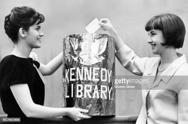 Hostess Linda Scott left and Mrs Rhyne Simpson add donation envelopes to a collection during a fundraising event for the Kennedy Memorial Library in...