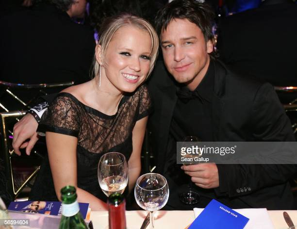 TV hostess Nova Meierhenrich and David Jost sit at a table at the 33rd annual German Film Ball at the Bayerische Hof Hotel on January 14 2006 in...