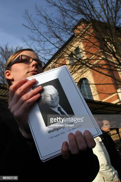 A hostess of the festival opera house distributes leaflets with the portrait of Wolfgang Wagner after the funeral service for Wolfgang Wagner at...