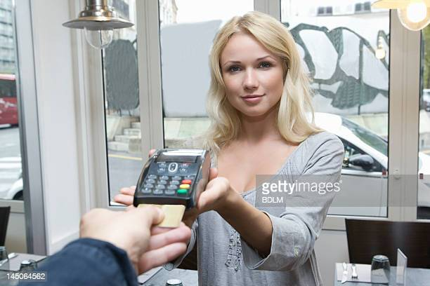 Hostess offering credit card machine