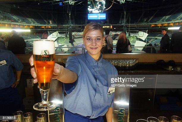 OUT== A hostess offers a cup o beer 23 March 2004 in Prague in the VIP area of the new Sazka Arena multipurpose hall which will host the 24 April09...
