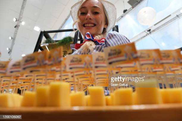 Hostess offers cheese samples to visitors at a Dutch stand at the Green Week agricultural trade fair on January 17, 2020 in Berlin, Germany. Green...