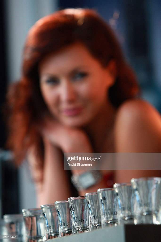 A hostess offers shots of Russian Standard vodka at the first Barman's festival held for food and drink professionals on July 1, 2008 in Tel Aviv, Israel. For three nights, Israel's bar and restaurant staff were treated to cocktails and testing's of some of the best imported vodkas, whiskies and beers imported into the Jewish State.