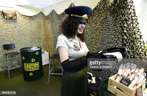 A hostess offers VR glasses at a booth promoting VR pictures of Chernobyl at the International Tourism Trade Fair in Berlin on March 8 2018 The...