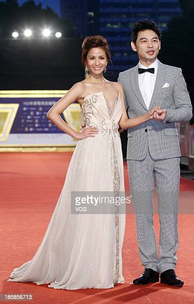 Hostess Patty Wu and host Ken attend the red carpet of the 48th Golden Bell Award on October 25 2013 in Taipei Taiwan of China