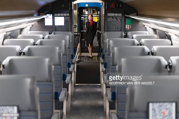 A hostess poses in a second class wagon of the new TGV high speed train called Euroduplex L'Oceane made by French trainmaker Alstom during its...