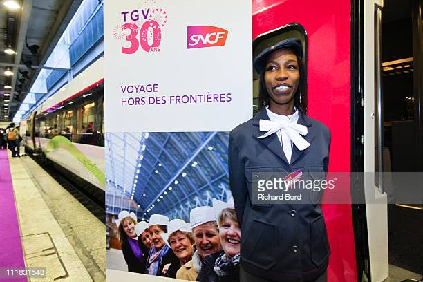 A hostess poses in front of the TGV Train during a SNCF presentation at Gare Montparnasse on April 7 2011 in Paris France French train company SNCF...