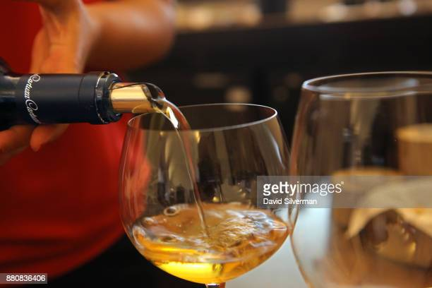 A hostess serves Adega da Cartuxa winery's 'DOC Alentejo Evora Branco 2012 50 Anos' white wine during a tasting at the winery on September 30 2016 in...