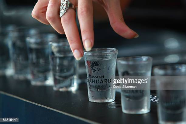 A hostess sets up shots of Russian Standard vodka at the first Barman's festival held for food and drink professionals on July 1 2008 in Tel Aviv...