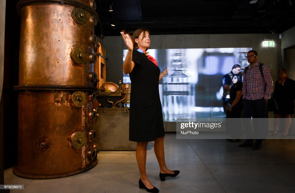 A hostess takes visitors on a tour at the opening of the Polish Vodka Musuem on June 12, 2018 in Warsaw, Poland.