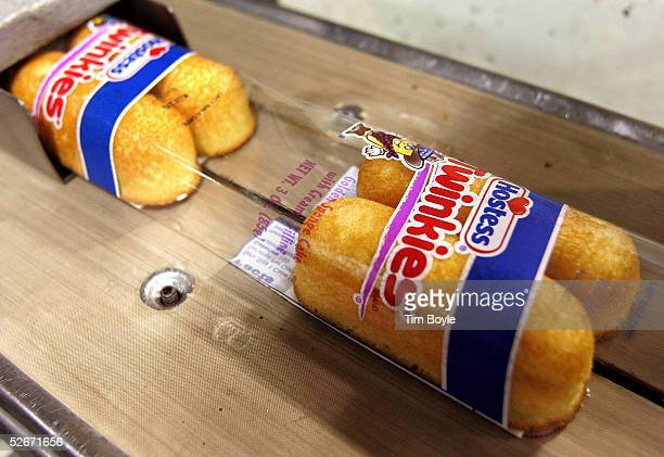 Hostess Twinkies move through the packaging process at the Interstate Bakeries Corporation facility April 20 2005 in Schiller Park Illinois a suburb...