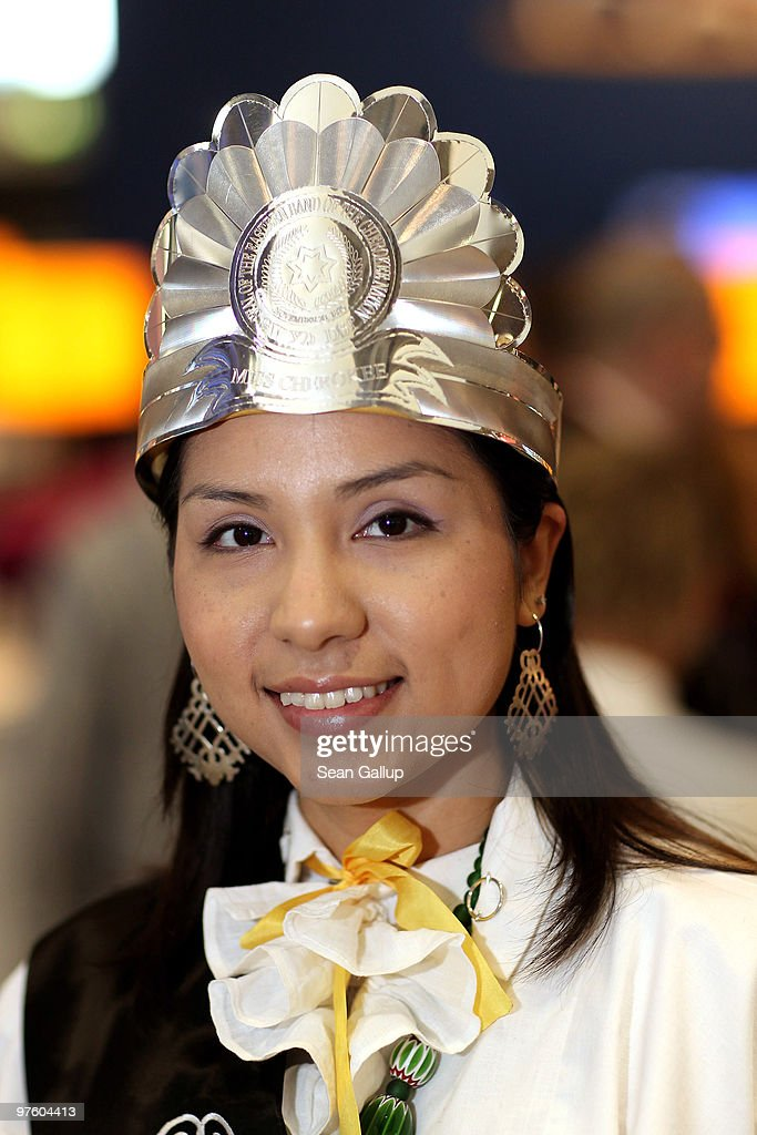 A hostess wearing traditional dress from the Cherokee tribe in
