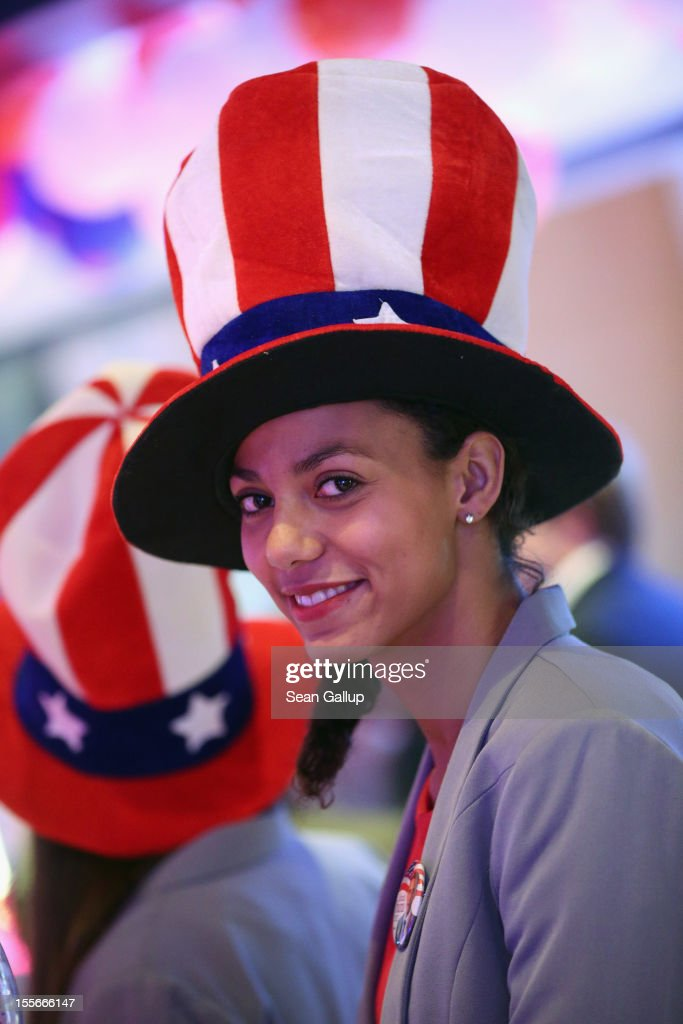 A hostess wears an American flag hat while attending a U.S. election party at the Bertelsmann Foundation on November 6, 2012 in Berlin, Germany. Polls suggest today's voting in American presidential elections will create a neck and neck race between incumbent Democrat President Barack Obama and his opponent, Republican Mitt Romney.