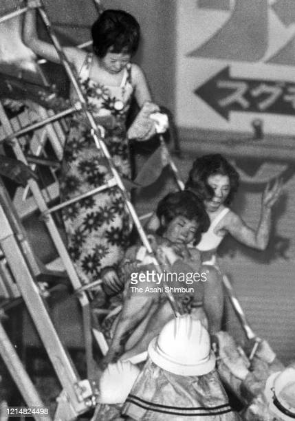 Hostesses evacuate from 7th floor where a cabalet Play Town is located at Sennichi Department Store fire on May 13 1972 in Osaka Japan 118 People...