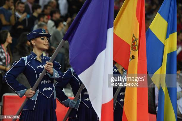Hostesses hold flags of France Spain and Sweden after the final match of the Men's 2018 EHF European Handball Championship between Spain and Sweden...