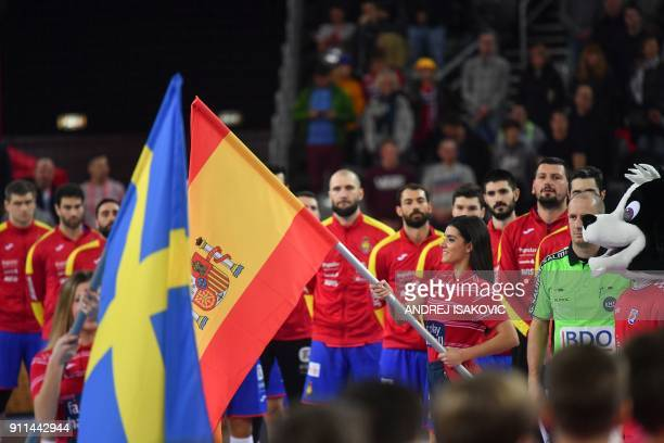 Hostesses hold the teams' flags prior to the final match of the Men's 2018 EHF European Handball Championship between Spain and Sweden on January 28...