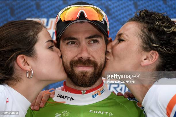 Hostesses kiss Belgium's Thomas De Gendt of team Lotto Soudal during the final podium ceremony of the Tour de Romandie UCI Pro cycling race on April...