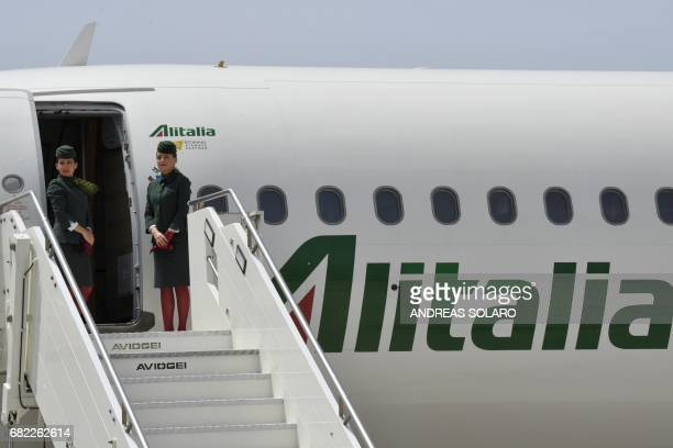Hostesses of Italian airline company Alitalia wait for the arrival of Pope Francis on May 12, 2017 before a papal flight to Portugal, at Fiumicino...