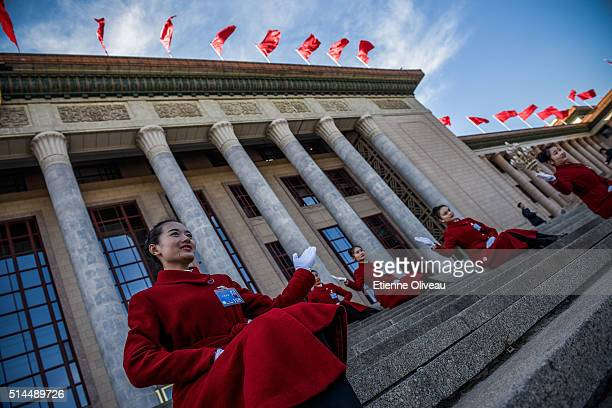Hostesses pose on the stairs of the Great Hall of the People before the Second Plenary Meeting of the National People's Congress,on March 9, 2016 in...