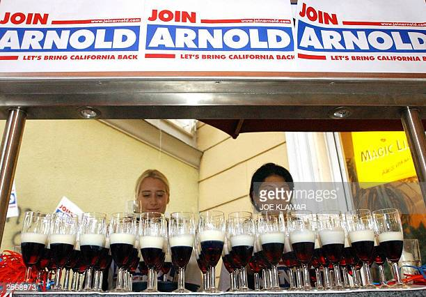 Hostesses prepare Stars and Stripes drinks in Stern bar in Graz 07 October 2003 where Arnold Schwarzenegger's friends officials and Austrian...