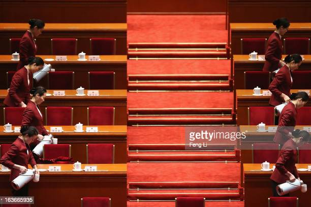 Hostesses serve tea before the fourth plenary meeting of the National People's Congress at the Great Hall of the People on March 14, 2013 in Beijing,...