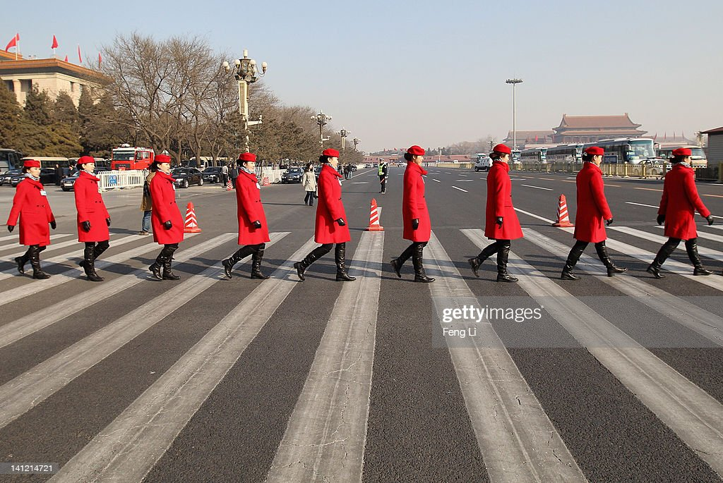 Hostesses walk outside the Great Hall of the People during the closing ceremony of the Chinese People's Political Consultative Conference (CPPCC) on March 13, 2012 in Beijing, China. Known as 'liang hui,' or 'two organizations', it consists of meetings of China's legislature, the National People's Congress (NPC), and its advisory auxiliary, the Chinese People's Political Consultative Conference (CPPCC).