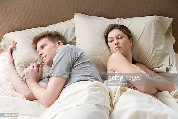 Hostile couple in bed