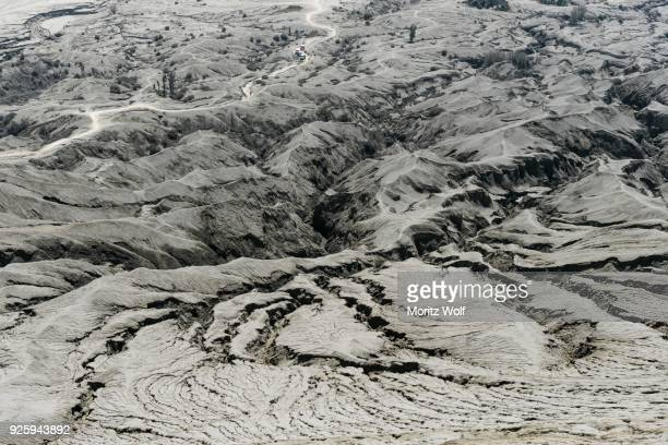 hostile volcanic landscape, gaps and cracks, dry ground on volcano crater, mount bromo, bromo tengger semeru national park, java, indonesia - bromo crater stock pictures, royalty-free photos & images