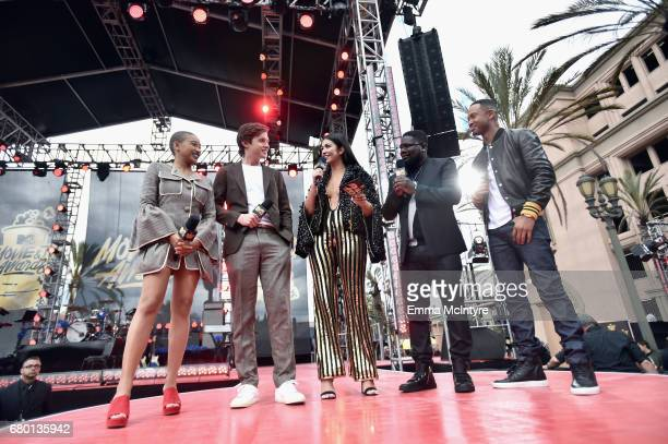 Hosts Amandla Stenberg Nick Robinson Gaby Wilson actor Lil Rel Howery and television peronality Terrence J attend the 2017 MTV Movie And TV Awards...