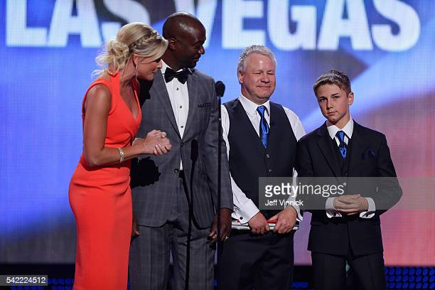 Hosts and presenters Kathryn Tappen Anson Carter Gerry Nelson and son Wyatt Nelson present the Masterton Trophy during the 2016 NHL Awards at The...