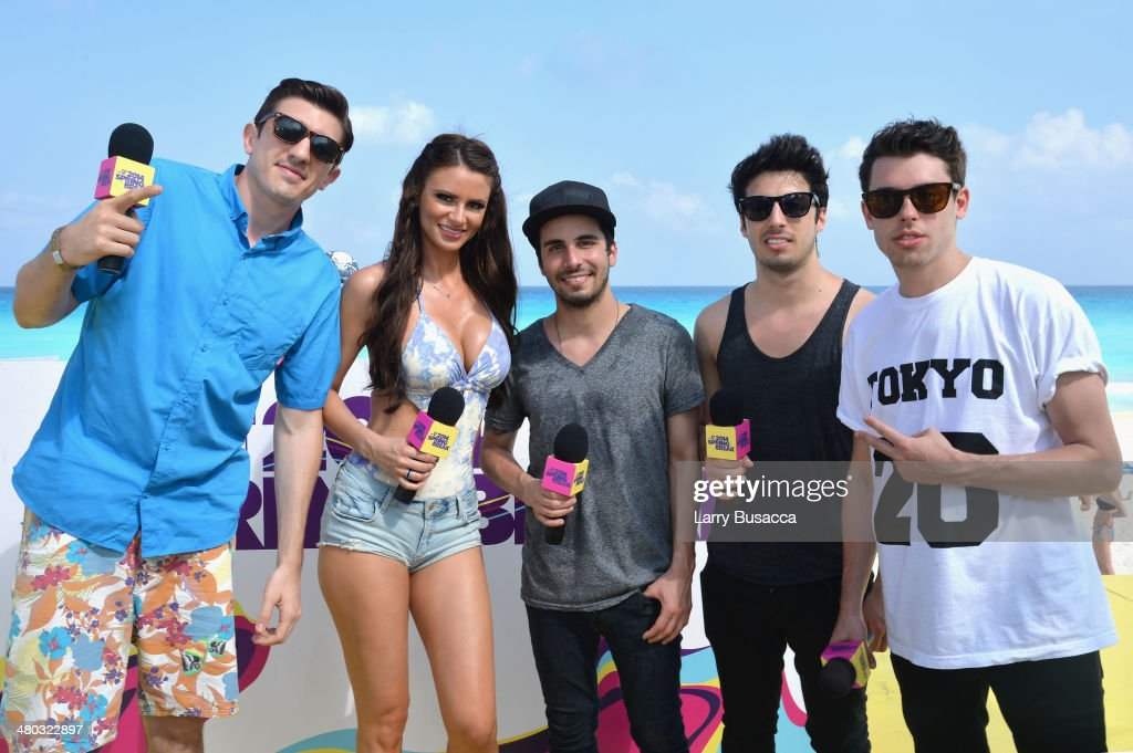 Hosts Andrew Schulz and April Rose, and Jean Paul Makhlouf, Alex Makhlouf, and Samuel Frisch of Cash Cash attend mtvU Spring Break 2014 at the Grand Oasis Hotel on March 21, 2014 in Cancun, Mexico.'mtvU Spring Break' starts airing March 31st on mtvU.
