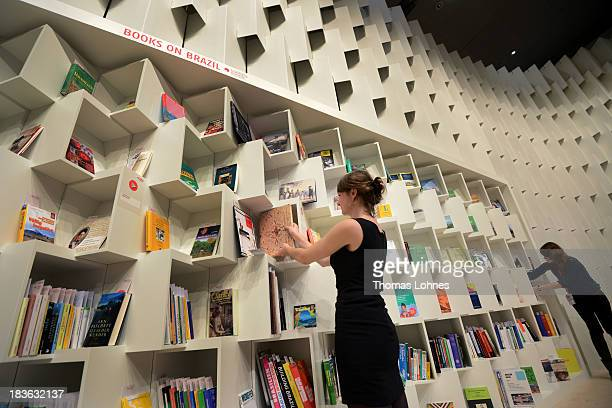 Hosts arrange books at the exhibition of Guest of Honour 'Brazil' a day before the launch of the 2013 Frankfurt Book Fair on October 8 2013 in...