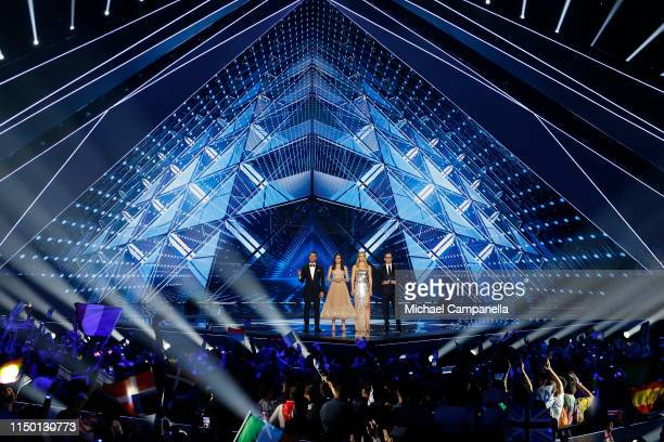 Hosts Assi Azar Lucy Ayoub Bar Refaeli and Erez Tal on stage during the 64th annual Eurovision Song Contest held at Tel Aviv Fairgrounds on May 18...