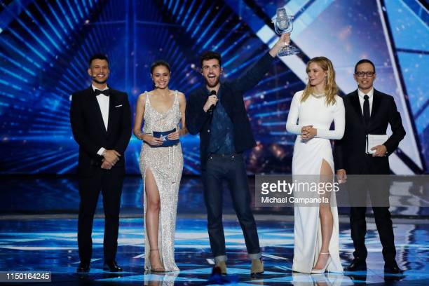 Hosts Assi Azar Lucy Ayoub Duncan Laurence with the 2019 trophy Bar Refaeli and Erez Tal on stage after the 64th annual Eurovision Song Contest held...