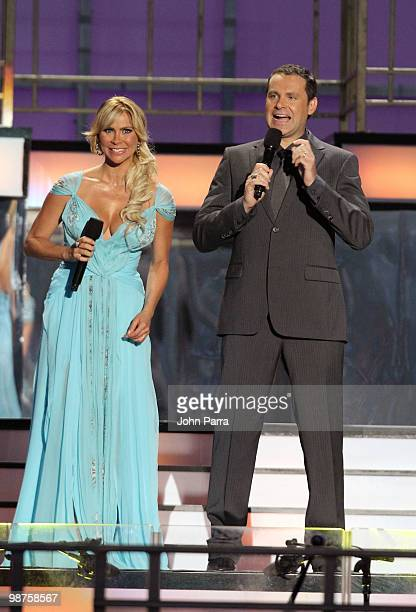 Hosts Aylin Mujica and Alan Tacher speak onstage at the 2010 Billboard Latin Music Awards at Coliseo de Puerto Rico José Miguel Agrelot on April 29...